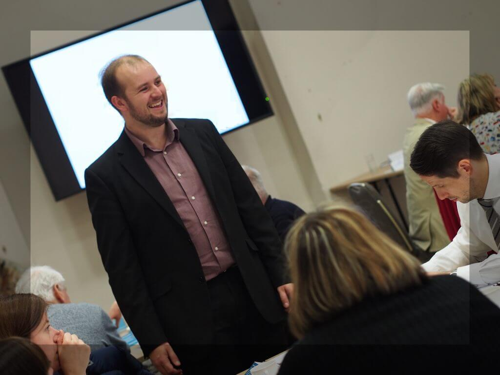 David delivering a training session to a room of arts fundraisers