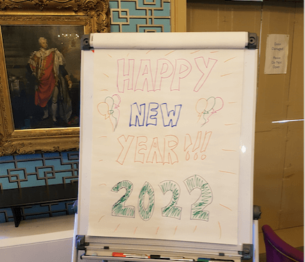 A flip chart saying Happy New Year 2022